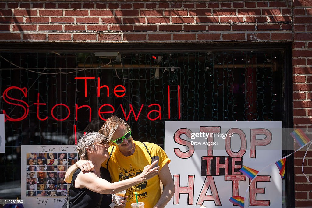 People take 'selfie' photographs in front of the Stonewall Inn on June 24, 2016 in New York City. President Barack Obama designated Stonewall Inn and approximately 7.7 acres surrounding it as the first national monument dedicated 'to tell the story of the struggle for LGBT rights.' The tavern is considered the birthplace of the modern gay rights movement, where patrons fought back against police persecution in 1969.