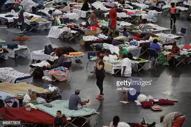 People take shelter at the George R Brown Convention Center after flood waters from Hurricane Harvey inundated the city on August 29 2017 in Houston...