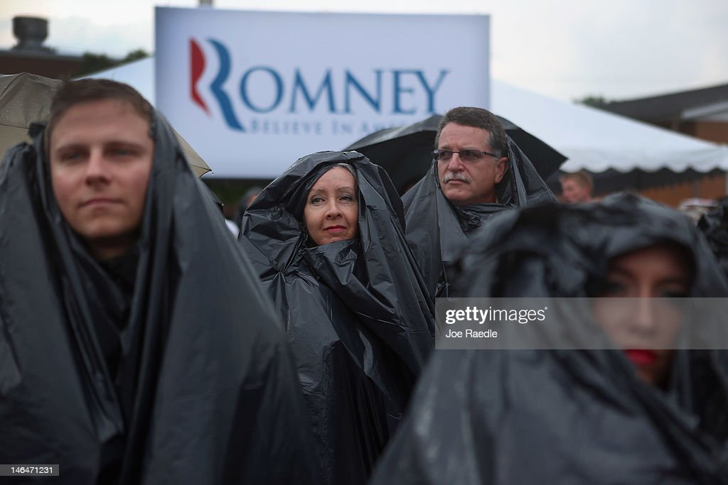 People take shelter under garbage bags from a downpour as they wait for the arrival of Republican Presidential candidate, former Massachusetts Governor Mitt Romney during a pancake breakfast campaign stop at Mapleside Farms on June 17, 2012 in Brunswick, Ohio. Romney is on a campaign swing through battleground states.