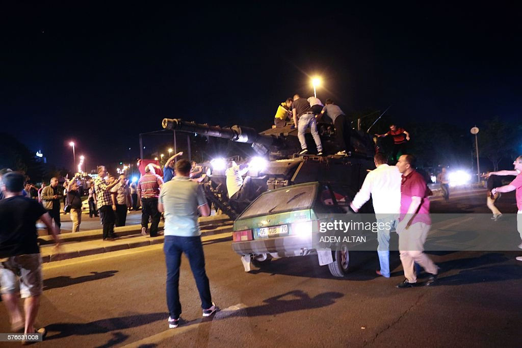 People take streets in Ankara Turkey during a protest against military coup on July 16 2016 TV citing prosecutor Turkish military forces on July 16...