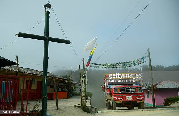 People take the traditional bus 'Chiva' in Pueblo Nuevo Briceño municipality Antioquia department Colombia on July 10 2016 day in which the...