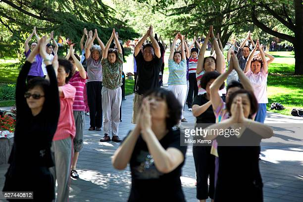People take their morning tai chi chuan exercise in Zizhuyuan Park in Beijing China This park is well known as a place where middle aged or elderly...