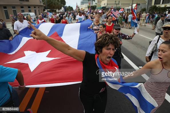 People take to the streets as they react to the news of the death of former Cuban President Fidel Castro outside the restaurant Versailles on...