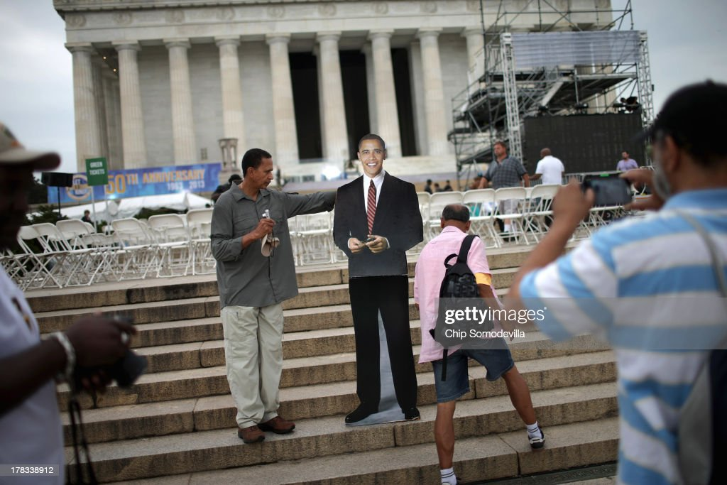 People take turns posing for photographs with a life-sized cardboard image of President Barack Obama on the steps of the Lincoln Memorial after the 'Let Freedom Ring Commemoration and Call to Action' honoring the 50th anniversary of the historic March on Washington for Jobs and Freedom on the National Mall August 28, 2013 in Washington, DC. The 1963 landmark civil rights event was where Dr. Martin Luther King Jr. delivered his famous speech, saying, 'I still have a dream. It is a dream deeply rooted in the American dream. I have a dream that one day this nation will rise up and live out the true meaning of its creed: 'We hold these truths to be self-evident: that all men are created equal.' I have a dream...'