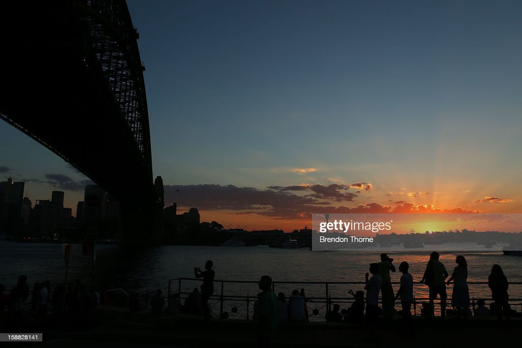People take up position along the harbour in anticipation of New Years Eve celebrations on Sydney Harbour on December 31, 2012 in Sydney, Australia.