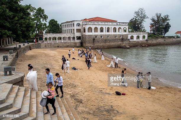 People take wedding photograph on the beach beside a historical villa which was built in 1918 by a Danish Telegraph Company Kulangsu is an island off...