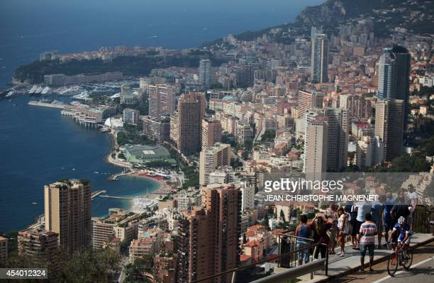 People takes pictures of Monaco on August 23 in RoquebruneCapMartin southeastern France AFP PHOTO / JEAN CHRISTOPHE MAGNENET