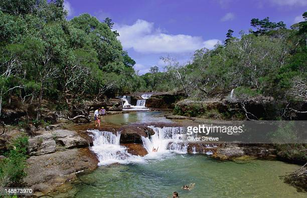 People taking a dip in the cool waters of Twin Falls on the Cape York Peninsula.