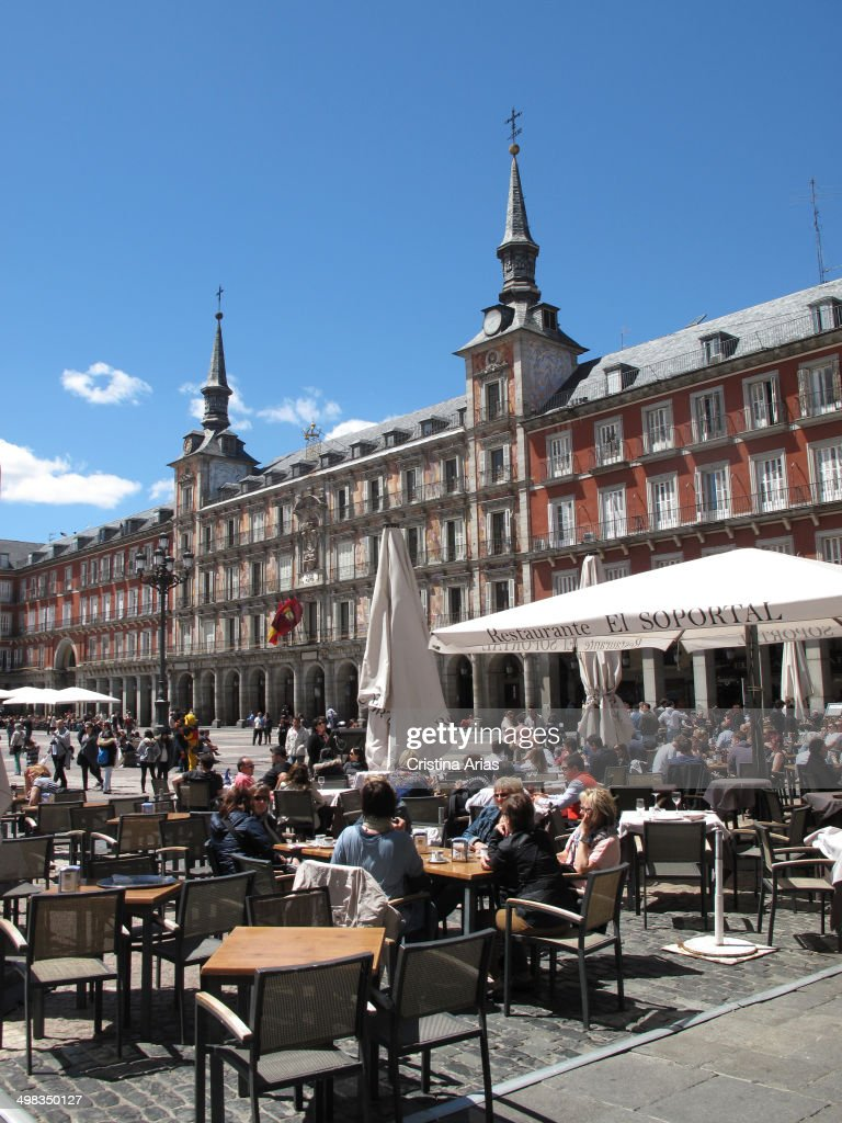 People taking a snack on the terrace of a restaurant in the Plaza Mayor of Madrid Spain May 2014