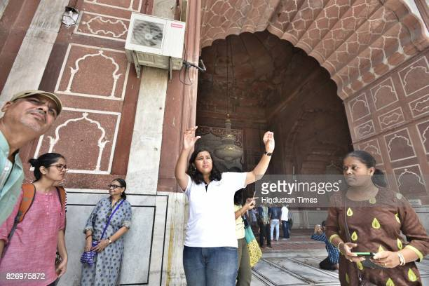 People taking 'Delhi Heritage Walk' tour at Jama Masjid on August 6 2017 in New Delhi India DMRC has tied up with Delhi Walks which specializes in...