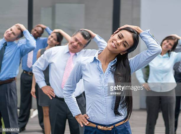 People taking in an active break at the office