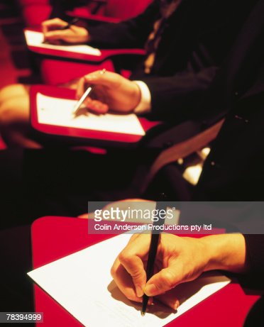 People taking notes at conference