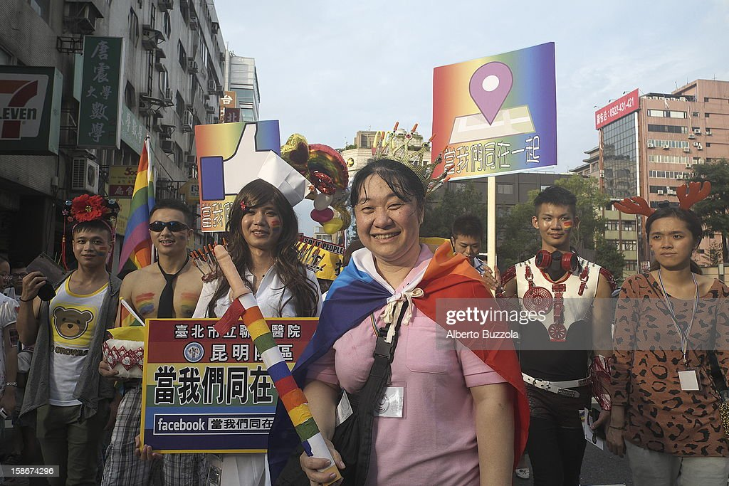 People taking part at the Taipei Gay Pride parade, parade through the streets of Taipei City. Some wearing colorful costumes..