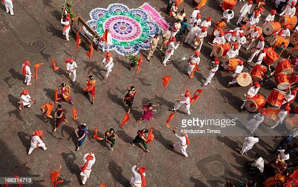 People taking part in procession being taken out at Girgaum on the occasion of Gudi Padwa Marathi New year on April 11 2013 in Mumbai India...
