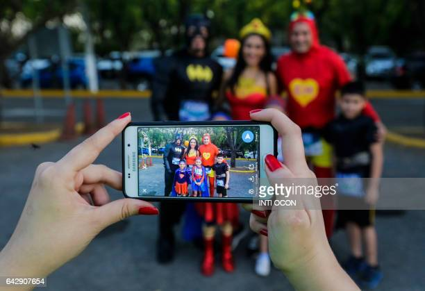 People taking part in the '5K Heroes with True Battles' in support of children with cancer pose for pictures in Managua on February 19 2017 People of...