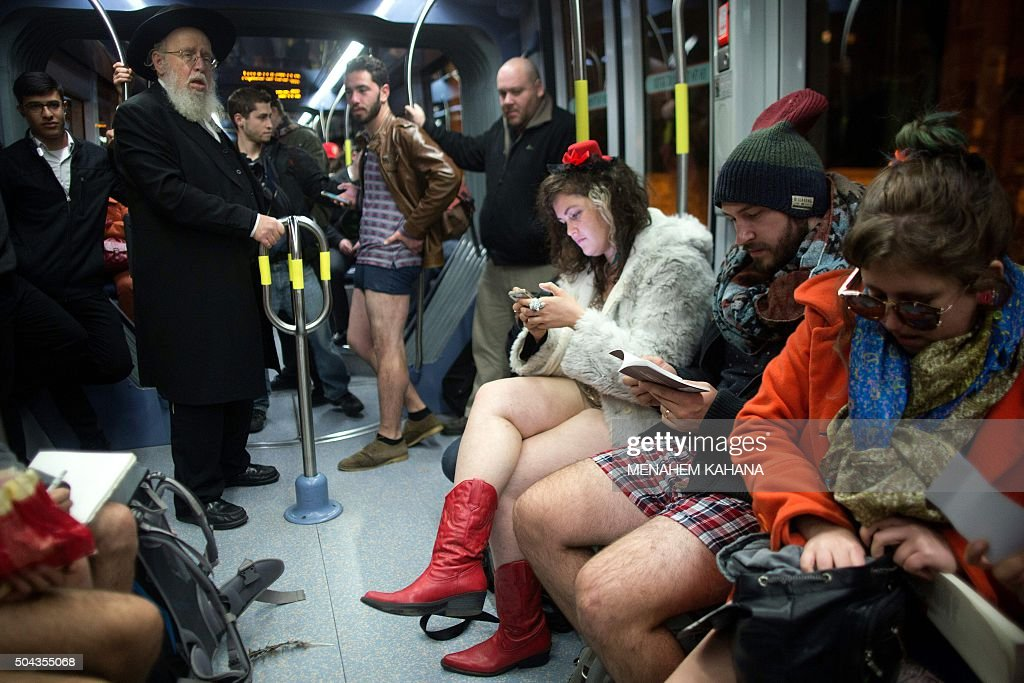 People taking part in the annual international 'No Pants Subway Ride' day travel on the Jerusalem light train on January 10 2016 The 'no pants' day...