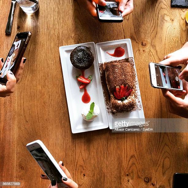 People Taking Picture Of Dessert