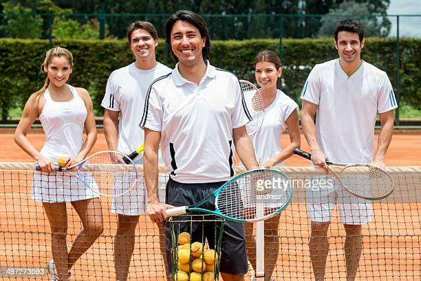 People taking tennis lessons
