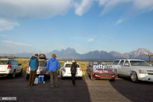 People talk as they wait for the total eclipse in Grand Teton National Park on August 21 2017 outside Jackson Wyoming Thousands of people have...
