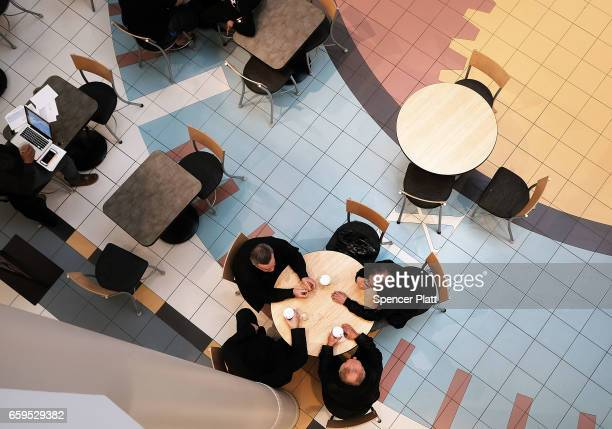 People talk at a coffee shop in a nearly empty shopping mall on March 28 2017 in Waterbury Connecticut As consumers buying habits change and more...