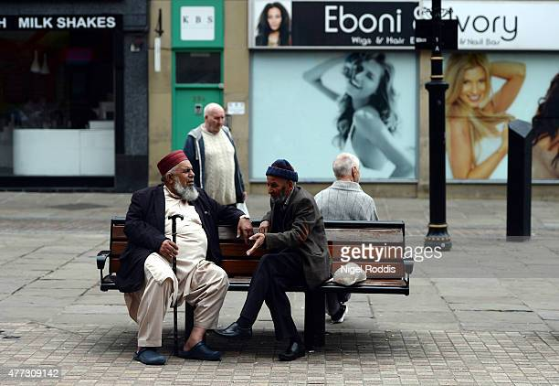 People talk in the city centre of Bradford on June 16 2015 in Bradford England Three sisters from Bradford are feared to have travelled to Syria with...