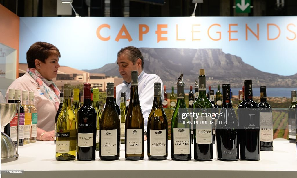 People talk on a stand of a South African wine producer at ...