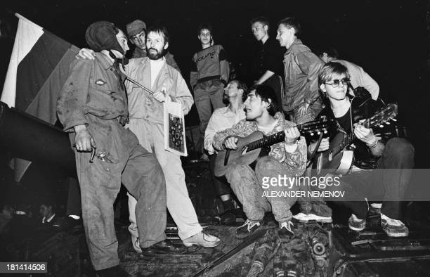 People talk to soldiers in front of the Russian White House in central Moscow early on August 20 1991 Russia marks on August 1922 the 20th...
