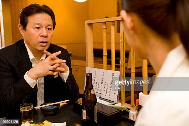 People Talking at Izakaya