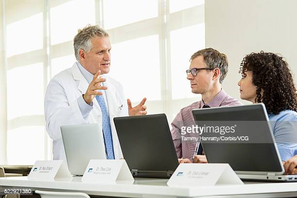 People talking at meeting