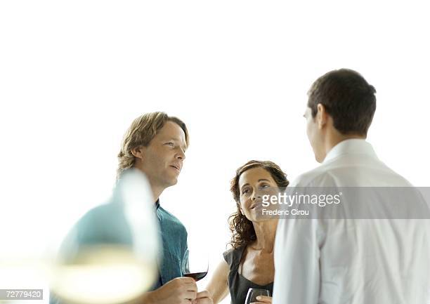 People talking during cocktail party