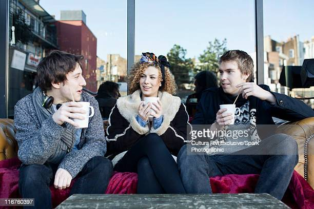 People talking on couch at coffee shop
