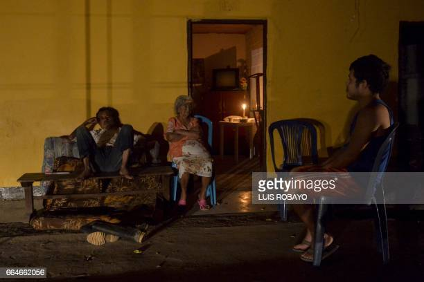 TOPSHOT People talks on streets of Mocoa Putumayo department Colombia on April 4 2017 The municipality of Mocoa remains without electricity and water...