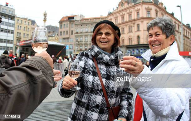 People taste a glass of wine in Brno during the Saint Martin Wine festival on November 11 2011 The tradition of St Martin wine which was restored in...