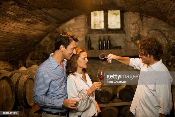 People tasting wine in cellar