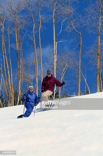 People Telemarking Down a Hill