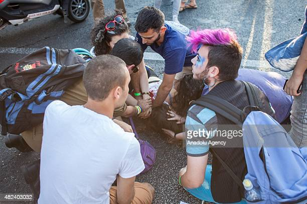 People tend to a woman who has been stabbed while marching in the gay pride parade on July 30 2015 in downtown Jerusalem Israel At least six people...