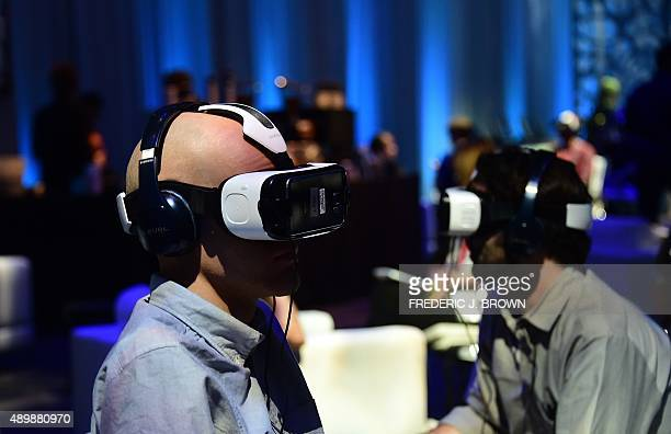 People test out the Oculusmade Samsung Gear VR Virtually Reality headset on display at the Oculus Connect 2 event in Hollywood California on...
