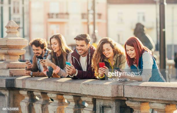 People texting in the city