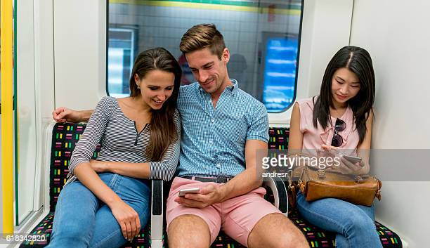 People texting while riding the metro