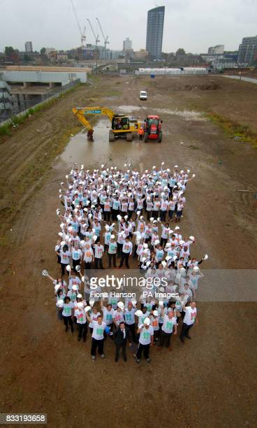 250 people the site of the Olympic Village next to Stratford International channel tunnel station form a giant '5' to mark the five year count down...