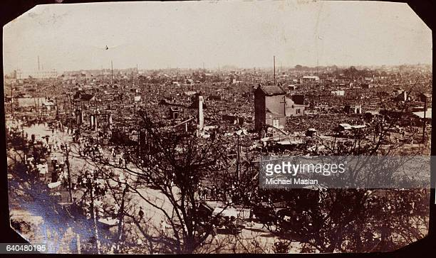 People throng a street amid the rubble in the razed city of Yokohama Japan destroyed by an earthquake and fire in 1923