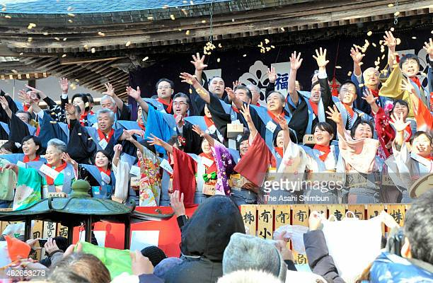 People throw beans during a beanscattering at Chusonji Temple ahead of the Setsubun end of winter day on February 1 2015 in Hiraizumi Iwate Japan The...