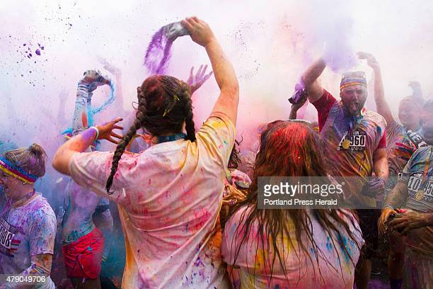 People throw color dust in the air during the postrace activity portion of the 5K Color Run in South Portland on Sunday June 26 2015 Founded in 2011...