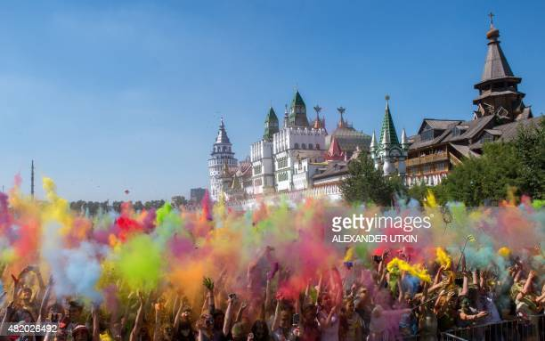 People throw coloured powder during the Holi Festival of Colours in Moscow on July 26 2015 Originally the festival was celebrated in northern India...