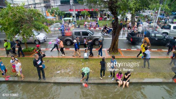 People throw water at each other during Thai New Year celebrations or Songkran at the moat surrounding the old city in Chiang Mai Possibly the...