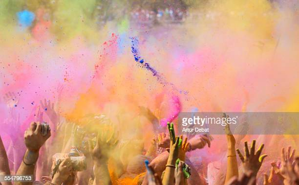 People throwing colorful powder in Holi