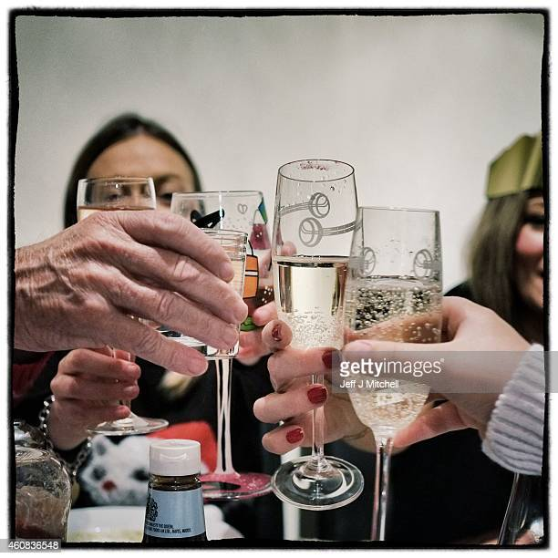 People toast during a Christmas dinner on December 25 2014 in Glasgow Scotland Millions of people across the UK spend time with family and loved ones...