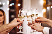 people toasting champagne at dinner