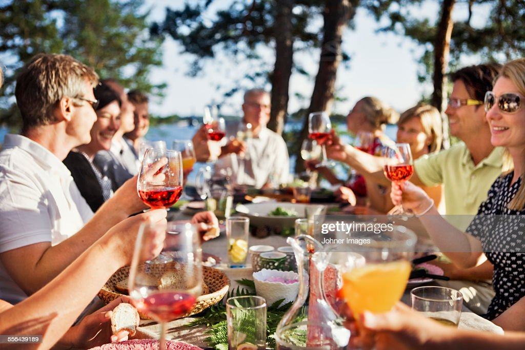 People toasting during meal