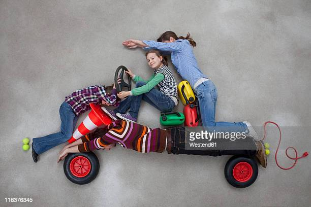 People together forming the shape of car